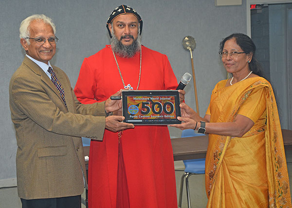 Theethose thirumeni formally releasing the Issue 500 Souvenir Edition of Malankara World Journal
