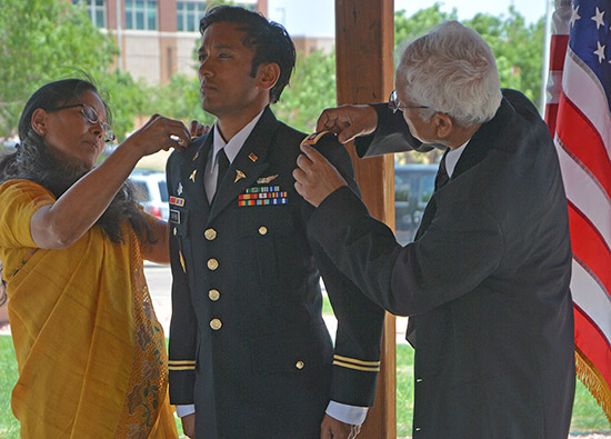Pinning the new patch of rank on Maj. Dr. Jacob Mathew, Jr.