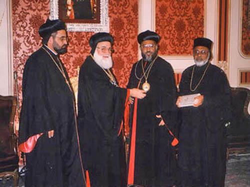 Patriarch HH Ignatius Zakka I Iwas presenting an icon/medal to Themotheos Thirumeni