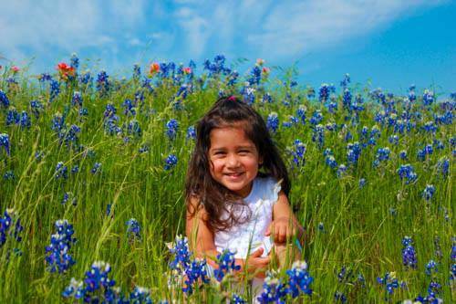 Maia Surrounded by Blue Bonnets in Hill Country, TX.  Photo by James Boroff