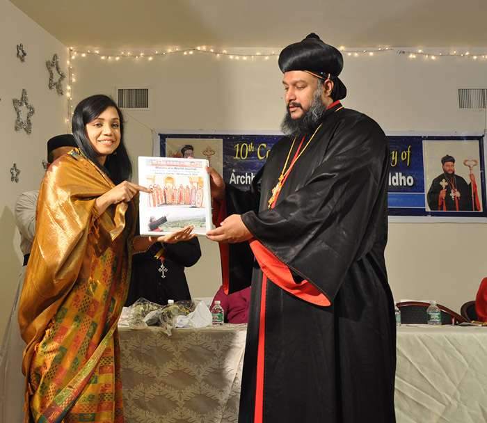 Sunitha Flowerhill presenting Issue 188 of Malankara World Journal to Theethose Thirumeni
