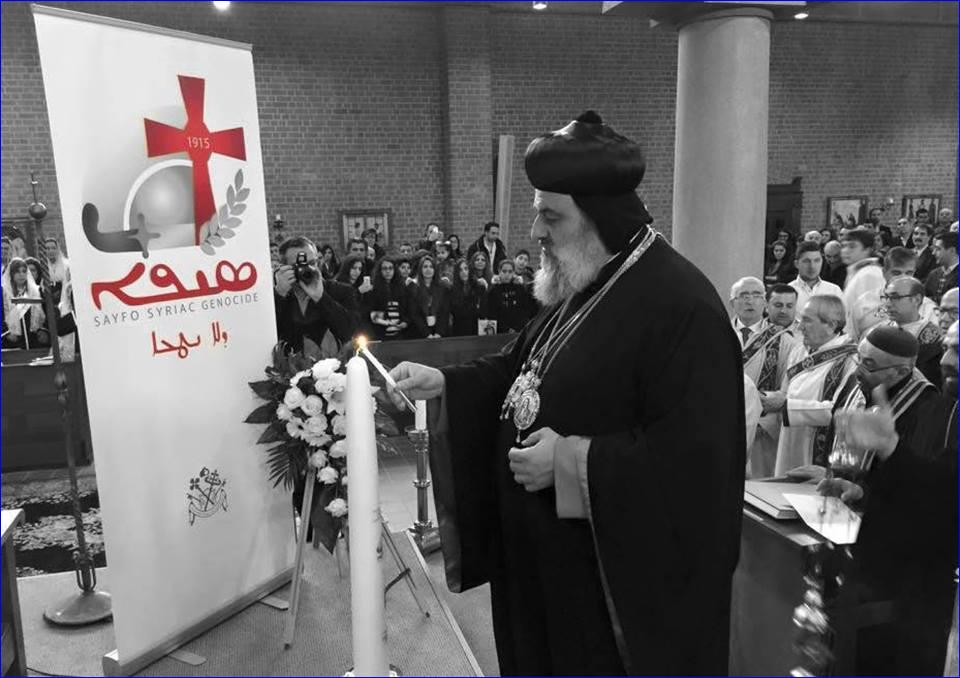 Patriarch Aphrem II lighting a candle at the Sayfo Centennial